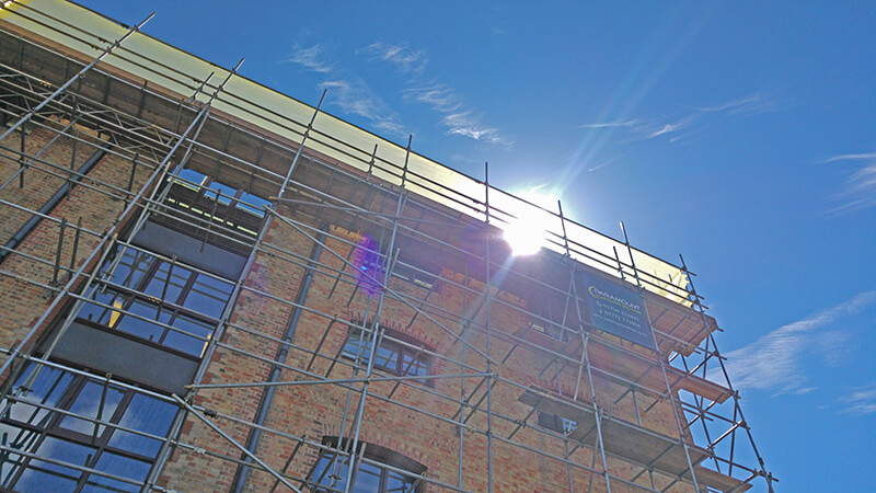 Photo looking up at office with scaffolding